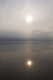 Calm Waters over North Sea Mud Flats with the Sun's Reflection