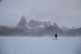 A Mountaineer Drags a Sled across the Antarctic Ice for a Circumnavigation of the Wohlthat Mountain