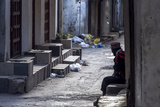 At Dawn a Muslim Man Rests on a Step in a Narrow Alley Waiting for Shops to Begin Trading