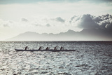 Men Paddle an Outrigger Canoe Off Tahiti Island  with Moorea Island in the Background