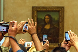 A Crowd of Tourists Photographing the Mona Lisa Portrait at the Louvre Museum