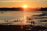 The Sun Setting over a Beach on Casco Bay