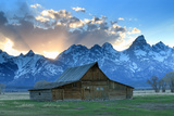 At Sunset  the Teton Range Rises Behind a Historic Barn on Mormon Row