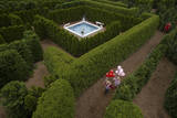 Young Girls Run with Balloons Through the Garden Maze at Luray  Virginia