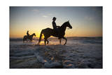 Cowboys Ride their Horses at Virginia Beach  at Sunrise