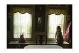 Two Dogs Look Out the Windows of a Home in Lincoln  Nebraska