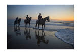 Cowboys Ride Horses on Virginia Beach at Sunrise  Virginia
