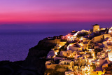 Dusk over the Aegean Sea and a White-Washed  Cliff-Top Town on Santorini Island