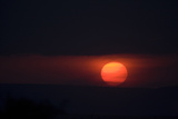 Orange Sunset on a Dark Horizon