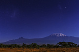 Mount Kilimanjaro in Moonlight the Large and Small Magellanic Clouds Appear to the Left