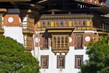 Ornately Carved and Painted Window Frames and Balconies on an Ancient Buddhist Monastery Facade