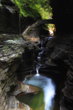 A Waterfall Cuts Through Rock in Watkins Glen State Park  Creating a Canyon