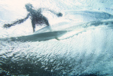 Underwater View of a Surfer on the Water's Surface