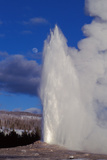 Old Faithful Erupts under a Three Quarter Moon