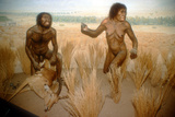 Models of a Stone Age Man and Woman Hunting