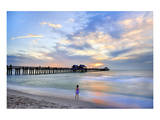 Girl in front of the Pier on the Beach of Naples on the Gulf Coast  Florida  USA