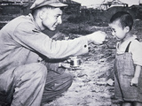 American Soldier Shares His Rations with South Korean Child