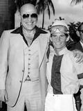 Actor Telly Savalas Poses with a Jockey at Hialeah Park  C1970