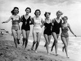 Six Women  in Swimsuits  Run in a Row Along a Beach  1942