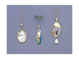 A Group of Liberty and Co Yellow Metal and Enamel Pendants and a Ring Designed by Archibald Knox