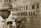 Carving the Name of Jesse Owens into the Champions' Plinth at the 1936 Summer Olympics