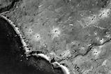 Dozens of Bombs Fall from a US Bomber Toward Japanese-Occupied Kiska Island