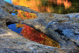 Autumn Colors Reflected in Pools of Water on a Rocky River Bank