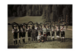 Folk Singers and Dancers Pose for Camera Holding Elaborate Wreaths