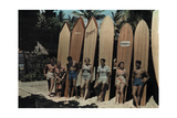 A Group of Surfers on Waikiki Beach Pose Leaning Against their Boards