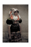 A Young Girl Wears the Sunday Costume and a Headdress with Fringe