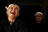 Two Dong Women  One Laughing  in a Dark Room  Sanjiang Dong Village  Guangxi  China