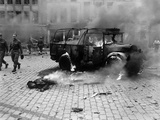 This Boy's Dead Body and Burning US Jeep after a V-2 Strike in Antwerp