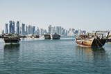 Downtown Doha with its Impressive Skyline of Skyscrapers and Authentic Dhows in the Bay