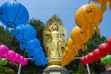 Colourful Paper Lanterns in Front of a Golden Buddha in the Fortress of Suwon
