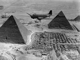 American Air Transport Command Plane Flies over the Pyramids of Egypt