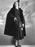 Loretta Young in Alaska Seal Cape Worn over Brown Woolen Dress Designed by Nina Foley
