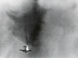 Allied Plane Burns Overhead During the 1st Allied Airborne Army's Assault Near Wesel