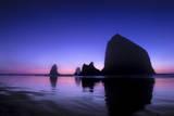 The Sun Sets Behind Haystack Rock at Cannon Beach  Oregon