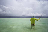 Male Angler and Guide Wade the Flats with Approaching Storm