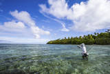 A Male Angler Making Casts on a Saltwater Flat at Alphonse Island  Seychelles