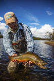A Male Fly Fishing Guide Holds a Beautiful Male Brook Trout
