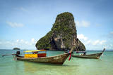 A Longtail Boat Floats Off Shore of Pranang Beach - Railay  Thailand