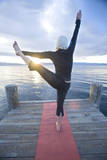 Young Woman Doing Yoga on Pier in Tahoe City  California