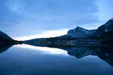Glacier  Montana: Many Glacier Lodge Reflects Off of Swifcurrent Lake During Sunrise