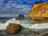Wave Crashes on Rock with Sandstone Cliff Glowing in Morning Light  Cape Kiwanda  Oregon