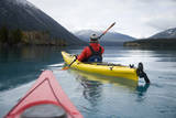 Young Woman Kayaking on Chilko Lake in British Columbia  Canada