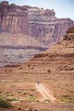 Male Endurance Cyclist Rides Mountain Bike on White Rim Trail in Canyonlands National Park  Utah
