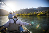 Two Male Fly Fishermen Bombing Streamers on the Rio Grande  Argentina