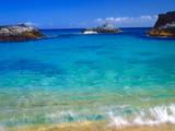 USA  Hawaii  Kauai a Wave Breaks on a Beach