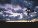 Windmill Silhouette under Broken Clouds